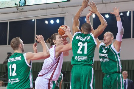 mikhail: SAMARA, RUSSIA - OCTOBER 24: Alexander Dedushkin of BC Krasnye Krylia with ball attacks a ring of BC UNICS October 24, 2010 in Samara, Russia.
