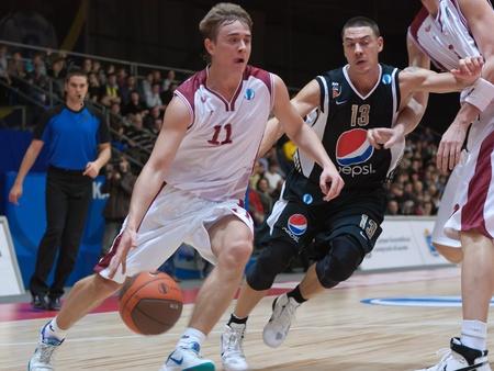TOLYATTI, RUSSIA - NOVEMBER 16: Alexander Anisimov of BC Krasnye Krylia defense held of BC JuveCaserta Basket November 16, 2010 in Tolyatti, Russia.