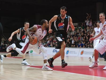 TOLYATTI, RUSSIA - NOVEMBER 16: J.R. Bremer of BC Krasnye Krylia defense held of BC JuveCaserta Basket November 16, 2010 in Tolyatti, Russia.