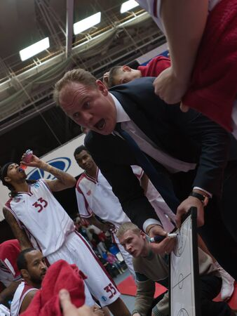 mikhail: TOLYATTI, RUSSIA - NOVEMBER 16: Coach of BC Krasnye Krylia Mikhail Mikhailov says the game plan BC JuveCaserta Basket November 16, 2010 in Tolyatti, Russia.