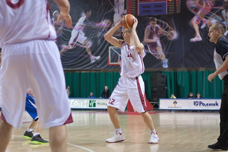 nesterov: SAMARA, RUSSIA - NOVEMBER 27: Konstantin Nesterov of BC Krasnye Krylia with ball attacking BC Irkut November 27, 2010 in Samara, Russia.