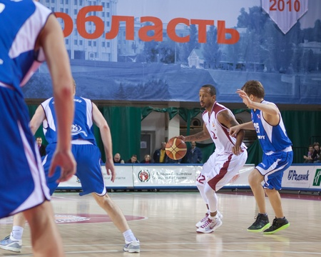 bc krasnye krylia samara: SAMARA, RUSSIA - NOVEMBER 27: Ernest J.R. Bremer of BC Krasnye Krylia with ball attacking BC Irkut November 27, 2010 in Samara, Russia.