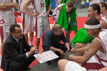 TOLYATTI, RUSSIA - DECEMBER 21: Coach of BC Krasnye Krylia Stanislav Eremin says the game plan December 21, 2010 in Tolyatti, Russia.