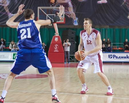 nesterov: SAMARA, RUSSIA - DECEMBER 18: Konstantin Nesterov of BC Krasnye Krylia with ball attacking player of BC Dynamo December 18, 2010 in Samara, Russia.