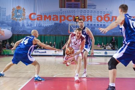 nesterov: SAMARA, RUSSIA - DECEMBER 18: Konstantin Nesterov of BC Krasnye Krylia with ball defense held of BC Dynamo December 18, 2010 in Samara, Russia. Editorial