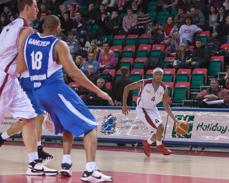 pbl: SAMARA, RUSSIA - JANUARY 06: Brion Rush of BC Krasnye Krylia with ball attacking BC Enisey January 06, 2011 in Samara, Russia.