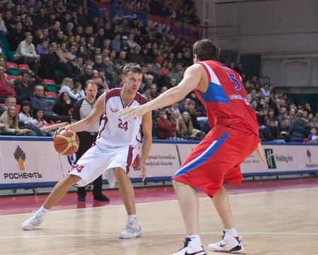 SAMARA, RUSSIA - JANUARY 09: Victor Zvarykin of BC Krasnye Krylia with ball attacking player of BC CSKA January 09, 2011 in Samara, Russia. Stock Photo - 8567822