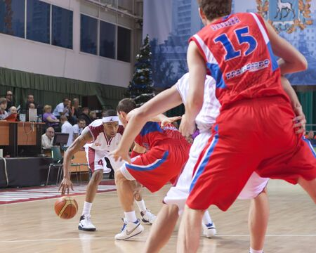 pbl: SAMARA, RUSSIA - JANUARY 09: Brion Rush of BC Krasnye Krylia with ball attacking player of BC CSKA January 09, 2011 in Samara, Russia.