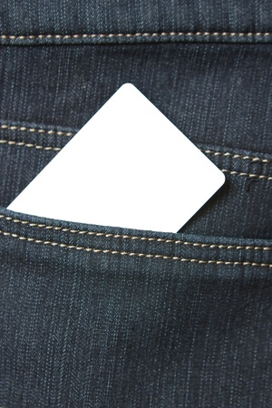 Blank card in the back pocket of jeans close-up photo