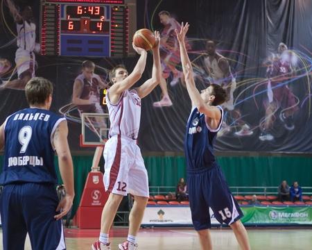 nesterov: SAMARA, RUSSIA - JANUARY 22: Konstantin Nesterov of BC Krasnye Krylia throws a ball in a basket of BC Triumph January 22, 2011 in Samara, Russia.