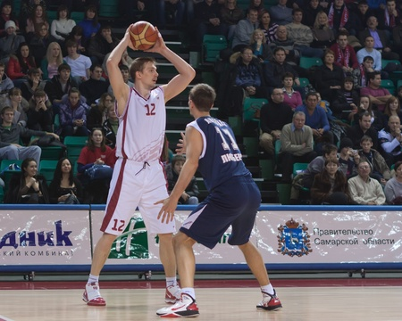nesterov: SAMARA, RUSSIA - JANUARY 22: Konstantin Nesterov of BC Krasnye Krylia with ball attacking player of BC Triumph January 22, 2011 in Samara, Russia.
