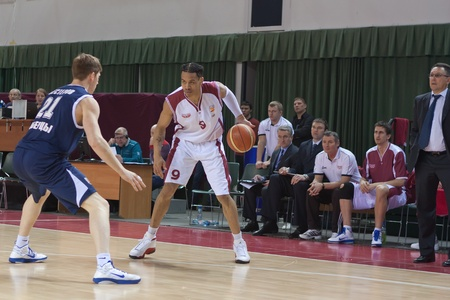 nesterov: SAMARA, RUSSIA - JANUARY 22: Gerald Green of BC Krasnye Krylia with ball attacking player of BC Triumph January 22, 2011 in Samara, Russia.