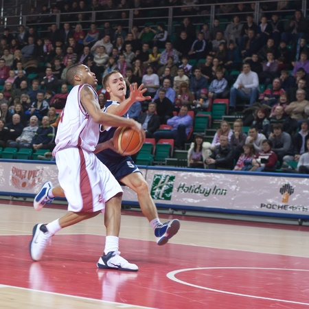 pbl: SAMARA, RUSSIA - JANUARY 22: Brion Rush of BC Krasnye Krylia with ball attacking BC Triumph January 22, 2011 in Samara, Russia.
