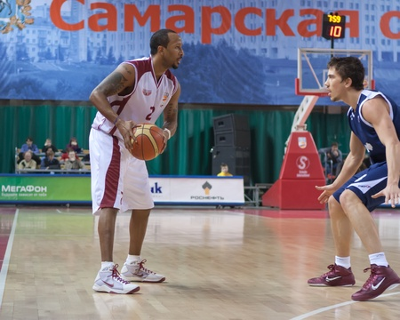 pbl: SAMARA, RUSSIA - JANUARY 22: Ernest J.R. Bremer of BC Krasnye Krylia with ball attacking player of BC Triumph January 22, 2011 in Samara, Russia.