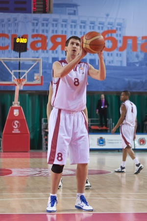 pbl: SAMARA, RUSSIA - JANUARY 22: Artem Kuzyakin of BC Krasnye Krylia breaks free throw BC Triumph January 22, 2011 in Samara, Russia.