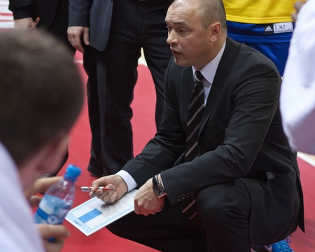 pbl: SAMARA, RUSSIA - FEBRUARY 06: Coach of BC Khimki Oleg Meleschenko says the game plan February 06, 2011 in Samara, Russia.
