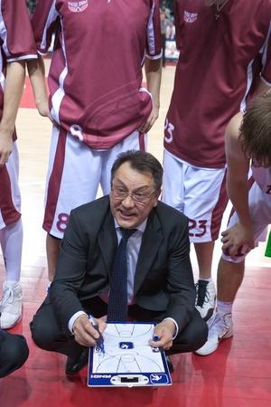 bc krasnye krylia samara: SAMARA, RUSSIA - FEBRUARY 12: Coach of BC Krasnye Krylia Stanislav Eremin says the game plan on February 12, 2011 in Samara, Russia.