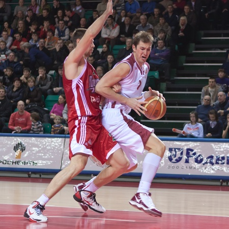 pbl: SAMARA, RUSSIA - FEBRUARY 12: Primoz Brezec of BC Krasnye Krylia with ball attacks player of BC Lokomotiv-Kuban February 12, 2011 in Samara, Russia.