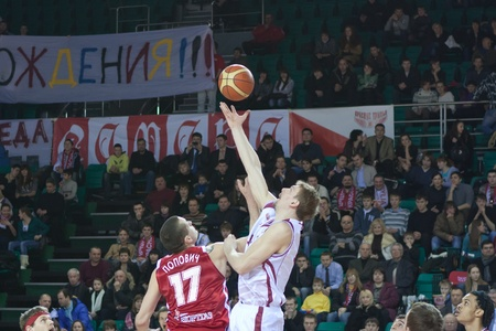 pbl: SAMARA, RUSSIA - FEBRUARY 25: Konstantin Nesterov of BC Krasnye Krylia win dropping the ball at the player of BC Spartak February 25, 2011 in Samara, Russia.