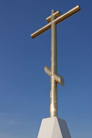 Orthodox Cross on a blue sky close-up photo