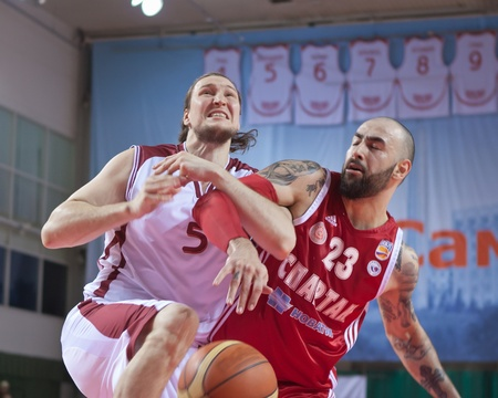 spartak: SAMARA, RUSSIA - APRIL 23: Alexander Dedushkin of BC Krasnye Krylia in the fight for the ball with the player of BC Spartak St.-Petersburg April 23, 2011 in Samara, Russia.