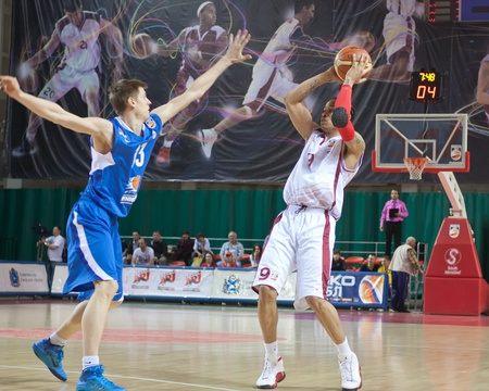 SAMARA, RUSSIA - MAY 11: Gerald Green of BC Krasnye Krylia with ball attacks player of BC Enisey May 11, 2011 in Samara, Russia.