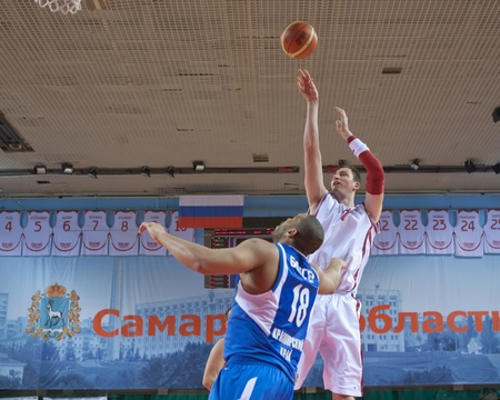 SAMARA, RUSSIA - MAY 11: Primoz Brezec of BC Krasnye Krylia throws a ball in a basket of BC Enisey on May 11, 2011 in Samara, Russia