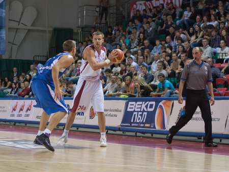 pbl: SAMARA, RUSSIA - MAY 11: Victor Zvarykin of BC Krasnye Krylia, with ball, is on the attack during a BC Enisey game on May 11, 2011 in Samara, Russia.