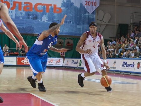 pbl: SAMARA, RUSSIA - MAY 11: Brion Rush of BC Krasnye Krylia, with ball, is on the attack during a BC Enisey game on May 11, 2011 in Samara, Russia.