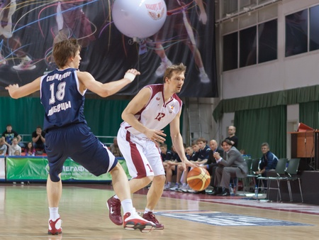nesterov: SAMARA, RUSSIA - MAY 15: Konstantin Nesterov of BC Krasnye Krylia with ball tries to go past a BC Triumph player on May 15, 2011 in Samara, Russia.