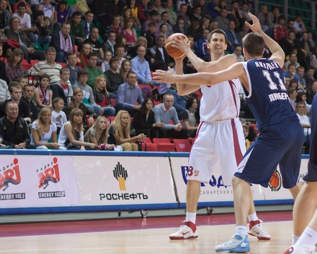 pbl: SAMARA, RUSSIA - MAY 15: Artem Kuzyakin of BC Krasnye Krylia with ball tries to go past a BC Triumph player on May 15, 2011 in Samara, Russia.