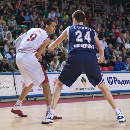 SAMARA, RUSSIA - MAY 15: Artem Kuzyakin of BC Krasnye Krylia tries to go past a BC Triumph player on May 15, 2011 in Samara, Russia. Editorial