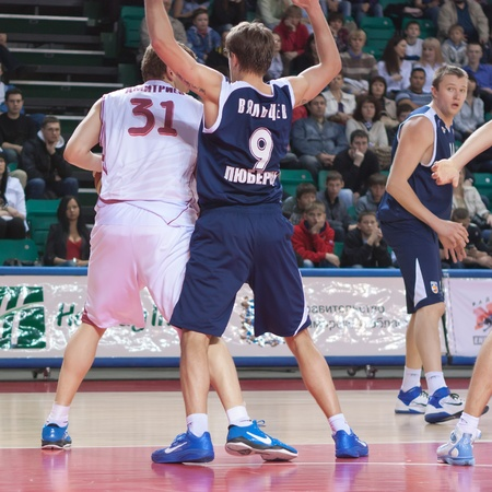 nesterov: SAMARA, RUSSIA - MAY 15: Fedor Dmitriev of BC Krasnye Krylia with ball tries to go past a BC Triumph players on May 15, 2011 in Samara, Russia. Editorial