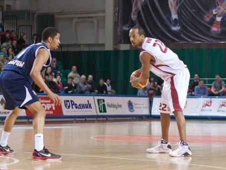 pbl: SAMARA, RUSSIA - MAY 15: Ernest J.R. Bremer of BC Krasnye Krylia with ball tries to go past a BC Triumph player on May 15, 2011 in Samara, Russia.