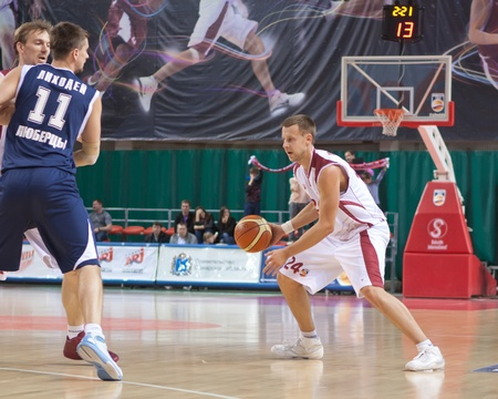 nesterov: SAMARA, RUSSIA - MAY 15: Victor Zvarykin of BC Krasnye Krylia, with ball, is on the attack during a BC Triumph game on May 15, 2011 in Samara, Russia.
