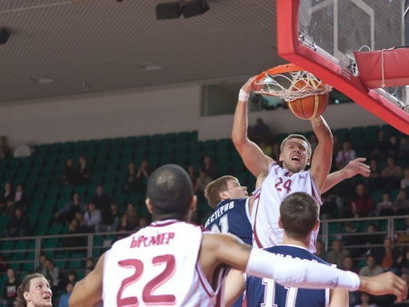 pbl: SAMARA, RUSSIA - MAY 15: Victor Zvarykin of BC Krasnye Krylia makes slam dunk in the game against BC Triumph on May 15, 2011 in Samara, Russia.