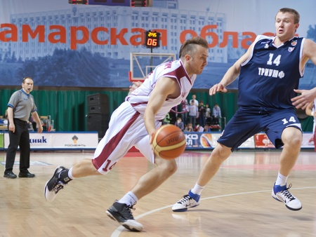 pbl: SAMARA, RUSSIA - MAY 15: Marko Marinovic of BC Krasnye Krylia with ball tries to go past a BC Triumph player on May 15, 2011 in Samara, Russia.