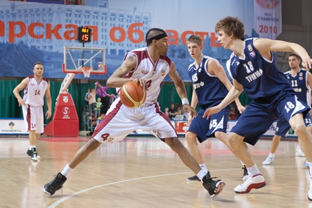 pbl: SAMARA, RUSSIA - MAY 15: Brion Rush of BC Krasnye Krylia with ball tries to go past a BC Triumph player on May 15, 2011 in Samara, Russia.