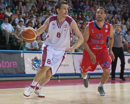 pbl: SAMARA, RUSSIA - MAY 26: Artem Kuzyakin of BC Krasnye Krylia, with ball, is on the attack during a BC CSKA game on May 26, 2011 in Samara, Russia.
