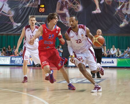 nesterov: SAMARA, RUSSIA - MAY 26: Ernest J.R. Bremer of BC Krasnye Krylia with ball tries to go past a BC CSKA player on May 26, 2011 in Samara, Russia.