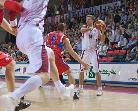 SAMARA, RUSSIA - MAY 26: Victor Zvarykin of BC Krasnye Krylia with ball tries to go past a BC CSKA player on May 26, 2011 in Samara, Russia. Stock Photo - 10404941