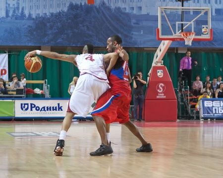pbl: SAMARA, RUSSIA - MAY 26: Brion Rush of BC Krasnye Krylia with ball tries to go past a BC CSKA player on May 26, 2011 in Samara, Russia.