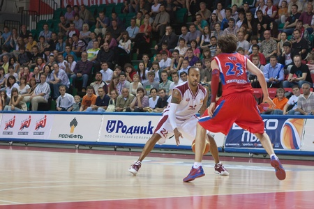 pbl: SAMARA, RUSSIA - MAY 26: Ernest J.R. Bremer of BC Krasnye Krylia with ball tries to go past a BC CSKA player on May 26, 2011 in Samara, Russia.