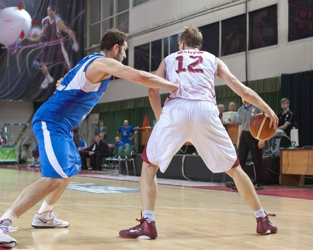 nesterov: SAMARA, RUSSIA - JUNE 04: Konstantin Nesterov of BC Krasnye Krylia with ball tries to go past a BC Enisey player on June 04, 2011 in Samara, Russia.