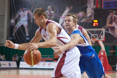 pbl: SAMARA, RUSSIA - JUNE 04: Victor Zvarykin of BC Krasnye Krylia, with ball, is on the attack during a BC Enisey game on June 04, 2011 in Samara, Russia. Editorial