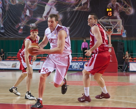 pbl: SAMARA, RUSSIA - JUNE 14: Andrey Trushkin of BC Krasnye Krylia, with ball, is on the attack during a BC Spartak game on June 14, 2011 in Samara, Russia.