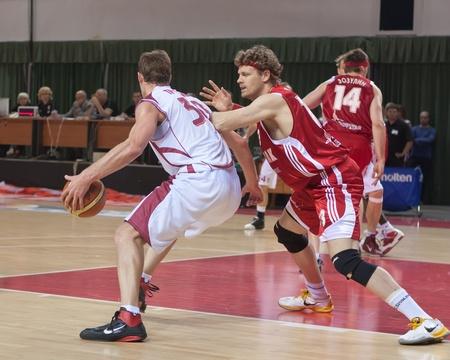 SAMARA, RUSSIA - JUNE 14: Andrey Trushkin of BC Krasnye Krylia with ball tries to go past a BC Spartak player on June 14, 2011 in Samara, Russia. Redakční