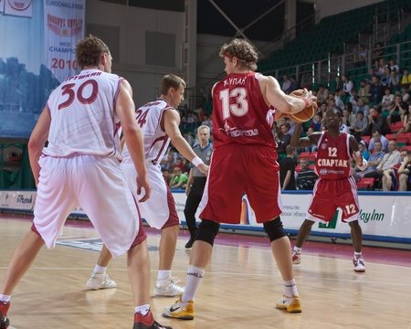 SAMARA, RUSSIA - JUNE 14: Zupan Miha of BC Spartak with ball tries to go past a BC Krasnye Krylia player on June 14, 2011 in Samara, Russia.