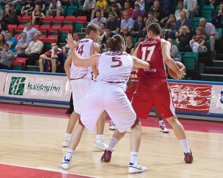 pbl: SAMARA, RUSSIA - JUNE 14: Popovic Petar of BC Spartak with ball tries to go past a BC Krasnye Krylia player on June 14, 2011 in Samara, Russia. Editorial