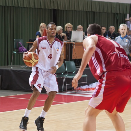 pbl: SAMARA, RUSSIA - JUNE 14: Brion Rush of BC Krasnye Krylia with ball goes against a BC Spartak player on June 14, 2011 in Samara, Russia. Editorial